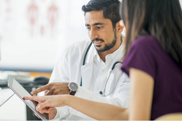 Doctor talking to patient